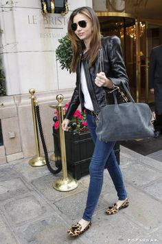 Even in the most laid-back outfit, Miranda exuded cool in a black leather jacket, skinny Frame denim, and leopard loafers in Paris.