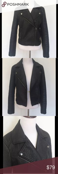 """Forever 21 Black Faux Leather Motorcycle Jacket M Forever 21 Black Faux Pebble Leather Heavy Motorcycle Jacket Biker Steampunk M  eavy faux leather pebble motorcycle jacket. LOOKS like real quality leather but it is fake leather. Motorcycle style with 2 front zippered pockets and zippers at cuffs. There are buttons inside to snap a hood on.   Great for the spring, burning man, and steampunk & cosplay outfits!  Size: Medium Bust (flat): 18""""  Length (from shoulder): 21""""  Sleeve (from armpit)…"""
