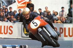 The great Mike Hailwood at the IOM on the 500 cc MV 4-cyclinder. If you look at the fairing you can see the damaged screen. Mike dropped it, kicked his machine back into shape and still won.