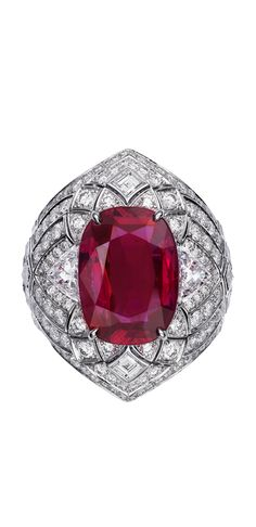 FLEUR DE LOTUS RING Platinum, one cushion-cut ruby (8.38 carats) from Burma, calibré-cut diamonds, brilliant-cut diamonds.