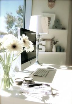 A view, computer, flowers and a wee dram of port helps a story come to life.................