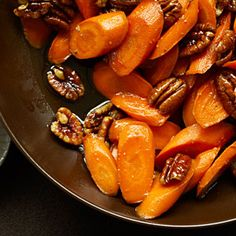 Recipe For Glazed Carrots with Pecans - This five-ingredient carrot side dish recipe comes together quickly and adds warm flavor to any menu.- So good and quick. I didn't add the pecans but I'm sure it would be tasty with them too! Veggie Dishes, Food Dishes, Side Dishes, Vegetable Sides, Vegetable Recipes, Pecan Recipes, Cooking Recipes, Carrot Recipes, Thanksgiving Recipes