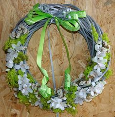 Wicker wreath with a white floral accent by Skygriffin on Etsy