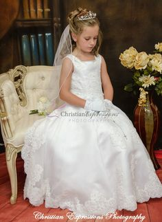This long length satin first communion gown features heavy beading throughout with exquisite pearl details along the neckline and arms. The skirt offers a split design with additional beading and lace details and lace hem. Designer First Communion Dresses, First Communion Veils, Girls Communion Dresses, First Holy Communion, Girls Dresses, Flower Girl Dresses, Lace Dresses, White Communion Dress, Shops