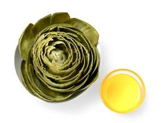 How to Eat an Artichoke : TIP: To check a steamed artichoke for doneness, stick a knife into the center — it should come out easily.