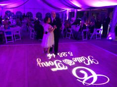 Purple uplighting and an elegant dance-floor monogram for a beautiful wedding at Raccoon Creek Golf Course.
