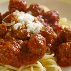 Italian Spaghetti Sauce with Meatballs - Big, tasty beef meatballs are simmered in an easy Italian tomato sauce in this easy recipe. Italian Spaghetti Sauce, Italian Tomato Sauce, Spaghetti And Meatballs, Italian Meatballs, Spaghetti Squash, Tomato Paste Recipe, Homemade Tomato Paste, Homemade Sauce, Homemade Spaghetti