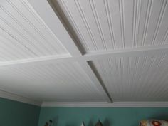 "Cover Popcorn Ceiling with Beadboard | Then we put up small (1""x3"") beams to hide the seams."