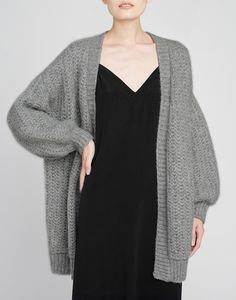 Envelop yourself in opulent comfort. Our oversized alpaca cardigan is hand-knit in Peru from premium baby alpaca that promises superior softness and elevated texture. Slip this open design over your shoulders at home as a chic layer, or wear it for day with anything in your closet. It ensures winter warmth and modern ease.