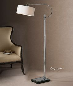 Uttermost Adara Glass & Chrome Floor Lamp. Ribbed glass column accented with polished chrome plated details and a matte black foot. The round hardback shade is an ivory linen fabric with natural slubbing.