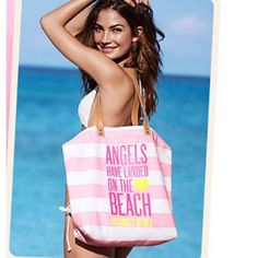 ☀️BRAND NEW VICTORIA'S SECRET BEACH TOTE☀️ NWOT Victoria's Secret Tote Bag White and Pink Striped  Brown Handles 'ANGELS HAVE LANDED ON THE BEACH' in Dark Pink Heart and 'VICTORIA'S SECRET' in Yellow Canvas 15 Inches Tall, 18 Inches Wide, 5 Inches Deep, 9.5 Inch Strap Drop 8 Ounces Victoria's Secret Bags Shoulder Bags