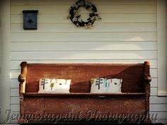 Antique Bench with 2 pillows a wreath of flowers by Jemvistaprint, $25.00
