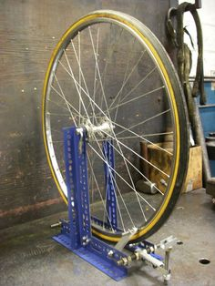 After the apparent success of my DIY wheel dishing tool I decided to take on the next obvious project: a wheel truing stand. I currently have seven bikes. That makes 14 wheels to maintain not coun… Mountain Bike Accessories, Mountain Bike Shoes, Mountain Bicycle, Mountain Biking, Bicycle Tools, Bicycle Wheel, Bicycle Stand, Trike Bicycle, Bicycle Shop