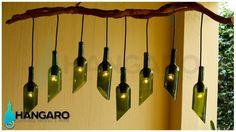 Lámpara con base de raíz de árbol con botellas de vino con corte inclinado. #Hangaro #Guatemala #CreacionChapina #Vidrio