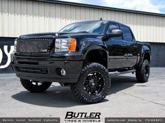 black lifted GMC truck
