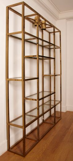 Large gilt brass shelves or bookcase. | From a unique collection of antique and modern shelves at https://www.1stdibs.com/furniture/storage-case-pieces/shelves/
