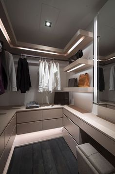 Wardrobe fit out with led lights below shelves and dressing table