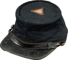 """Union Officer's Kepi with Original 4th Corps Badge Mounted on Top, Circa 1863/64. The original officer's style triangular 4th Corps badge is affixed to the top. 1 2/8"""" inches on a side, with edging of coiled brass wire and gold bullion. Center section of faded red wool denoting 1st Division."""