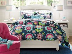 I love the PBteen Chelsea Papercut Floral Bedroom on pbteen.com.  Love the headboard set against windows.