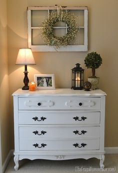 Love the window and wreath above the cute dresser!