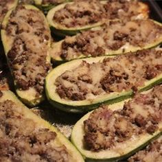 Zucchini halves are filled with ground chicken and provolone cheese, then topped with Parmesan cheese creating stuffed zucchini boats the whole family will love. Baked Zucchini Boats, Stuffed Zuchinni Boats, Bake Zucchini, Meat Recipes, Cooking Recipes, Chicken Recipes, Vegetable Recipes, Fall Recipes, Recipies