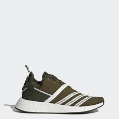 Futuristic NMD design is a natural fit for progressive Tokyo-based label White Mountaineering. Made with an adidas Primeknit upper for an ultra-comfy sock-like fit, these shoes feature reflective 3-Stripes wrapping diagonally. Finished with co-branding on the tongue, liner and heel.