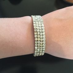 Silver Bracelet Silver Bracelet with diamond stones. Wraps around wrist. Worn only one time and in perfect condition! Jewelry Bracelets