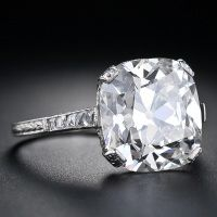this, but without all the diamonds on the setting    1STDIBS.COM Jewelry & Watches - 6.48 Carat Antique Cushion Cut Diamond ring - Lang Antiques