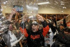 San Francisco Giants' manager Bruce Bochy celebrates with the championship trophy, as the Giants sweep the Detroit Tigers to win the World Series, photographed by Michael Macor (2012)
