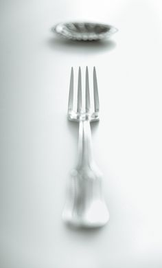 Black and white still life with fork and small copper dish. Published on foodfulife.com