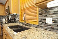 Woodbury, MN Kitchen Remodel - Cambria color Bradshaw counter tops, slate & glass back splash and Granite composite mocha under mount sink.