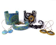 Decopatch over metal cuff and bangle bracelets.