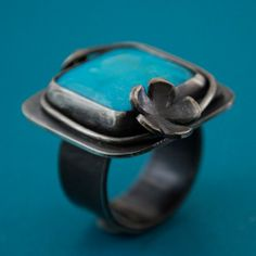 Turquoise Ring adorned with a sweet flower blossom by kathryncole, $154.00