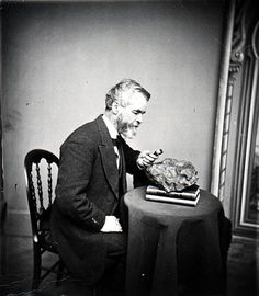 Unknown man looking at an unknown meteorite, date unknown.