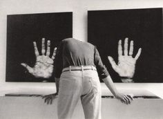 "Martine Franck FRANCE. Paris. 1977. Pompidou Centre, National Museum of Modern Art. ""Paris - New York"" exhibition. Photographs from the ""Handshow "" by the French artist Robert FILLIOU and the US artist Scott HYDE showing the hands of 24 artists."