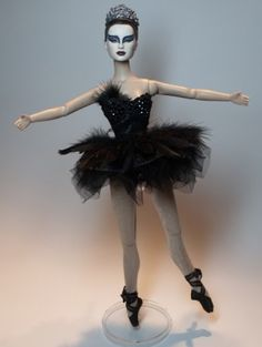About The Black Swan: This doll was created to resemble Natalie Portman in the movie The Black Swan.  She was auctioned on eBay, beginning the night Natalie won the oscar for her performance.  (Flutterwing Dolls by Shannon Craven www.flutterwing.com)