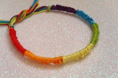 rainbow friendship bracelet $3Green: reliability, optimism, calm, harmony and honesty. Orange: cheerfulness, enthusiasm, stimulation and creativity. Yellow: attention-grabbing, comfort, optimism, summer, intellect, happiness and energy.   Blue: peace, professionalism, loyalty, reliability, honor, depth, stability and trust.  Purple: power, royalty, nobility, elegance, sophistication, mystery and magic. Black: Elegance, sophistication, formality, power and strength.