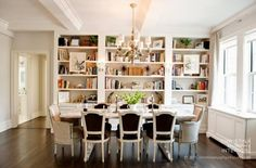 Imagine - host chairs in bold print fabric, the sputnik chandelier, I like the artwork on the bookcase to break it up a bit.   Marcus Design - Library Dining Rooms