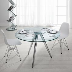 3149ae8ae100 Designed for Tonelli Design by Karim Rashid the Unity round glass dining  table is solidly built in a fantastic but practical design.