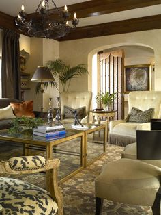 Old World design elements paired with traditional Mediterranean style. Venetian plastered walls, cypress beams and custom-made wrought iron lighting set an elegant tone upon entering the living room. Designer Troy Beasley mixes contemporary chairs, tables and accessories with charming Moorish art and rich, Tuscan hues.