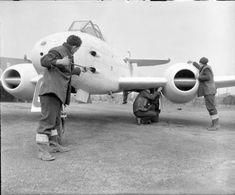 A British Gloster Meteor, the first operational Allied jet fighter, of No. 616 Squadron Royal Air Force being serviced. The Meteors were painted all white when operating over mainland Europe to avoid them being mistaken for German Me 262 jet. Navy Aircraft, Aircraft Photos, Military Jets, Military Aircraft, Jet Fight, Gloster Meteor, Ww2 Planes, Royal Air Force, Aviation Art