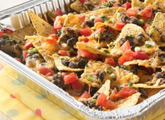 "Grilled Picnic Taco Nachos (www.tablespoon.com has lots of great recipes, even ""potluck."")"