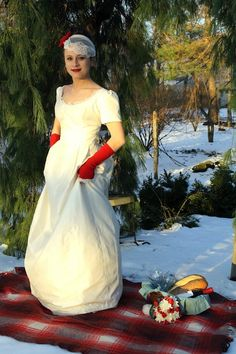Sleeves and red gloves! omg. PLUS: Solitary Pearl is offering discounts and deals on their ethical, custom, or DIY indie wedding gowns!