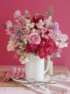 Love the pinks in the bouquet and love the pink wall.