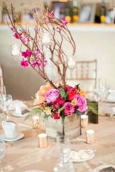 Manzanita Branch Centerpiece with hanging votives and orchids, Photo by Tamara Gruner