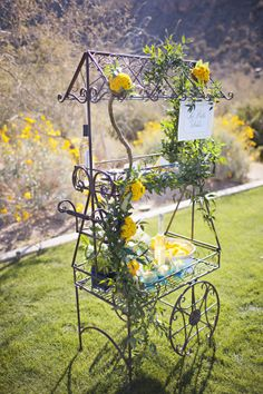 Wedding dessert cart display. Yellow and green flowers on iron cart. Gelato, cookies and sweet wine. Outside cart for guests during cocktail hoour. Ashley Gain Featured:: Arizona Foothills Magazine Dove Mountain Ritz Carlton