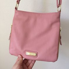 Steve Madden pastel pink LIKE NEW cross body bag A spring summery pastel pink Steve Madden small/med cross body bag, faux (fake) leather, LIKE NEW only used twice, no signs of wear really. Has zipper width extension on the sides (view photos) and has a few zipper compartments overall, cute simple bag. MEASUREMENTS: 10 inches L, 1 to 2 inches W, and 9.5 inches H. Bag strap is medium length and can adjust to longer or shorter lengths. Steve Madden Bags Crossbody Bags