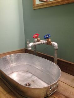 Galvanized piping faucet diy - would be great for a laundry sink.