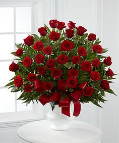 The Soul's Splendor Arrangement is a rich display of the love shared throughout the life of the deceased. Brilliant red roses are elegantly displayed in a white designer plastic urn and accented with lush greens and red satin ribbon Amazing Flowers, Beautiful Roses, Red Flowers, Red Roses, Beautiful Flowers, Red Rose Arrangements, Funeral Flower Arrangements, Church Flowers, Funeral Flowers