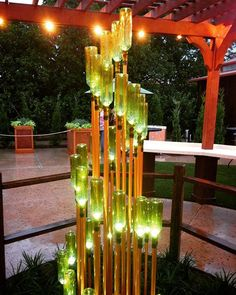 Spotted this gorgeous light fixture at Epcot. It's just green wine bottles copper-painted PVC pipe so great DIY potential! Spotted this gorgeous light fixture at Epcot. It's just green wine bottles copper-painted PVC pipe so great DIY potential! Wine Bottle Art, Wine Bottle Crafts, Diy Projects Glass Bottles, Cut Wine Bottles, Paint Wine Bottles, Wine Bottle Garden, Wine Bottle Trees, Wine Craft, Deco Originale